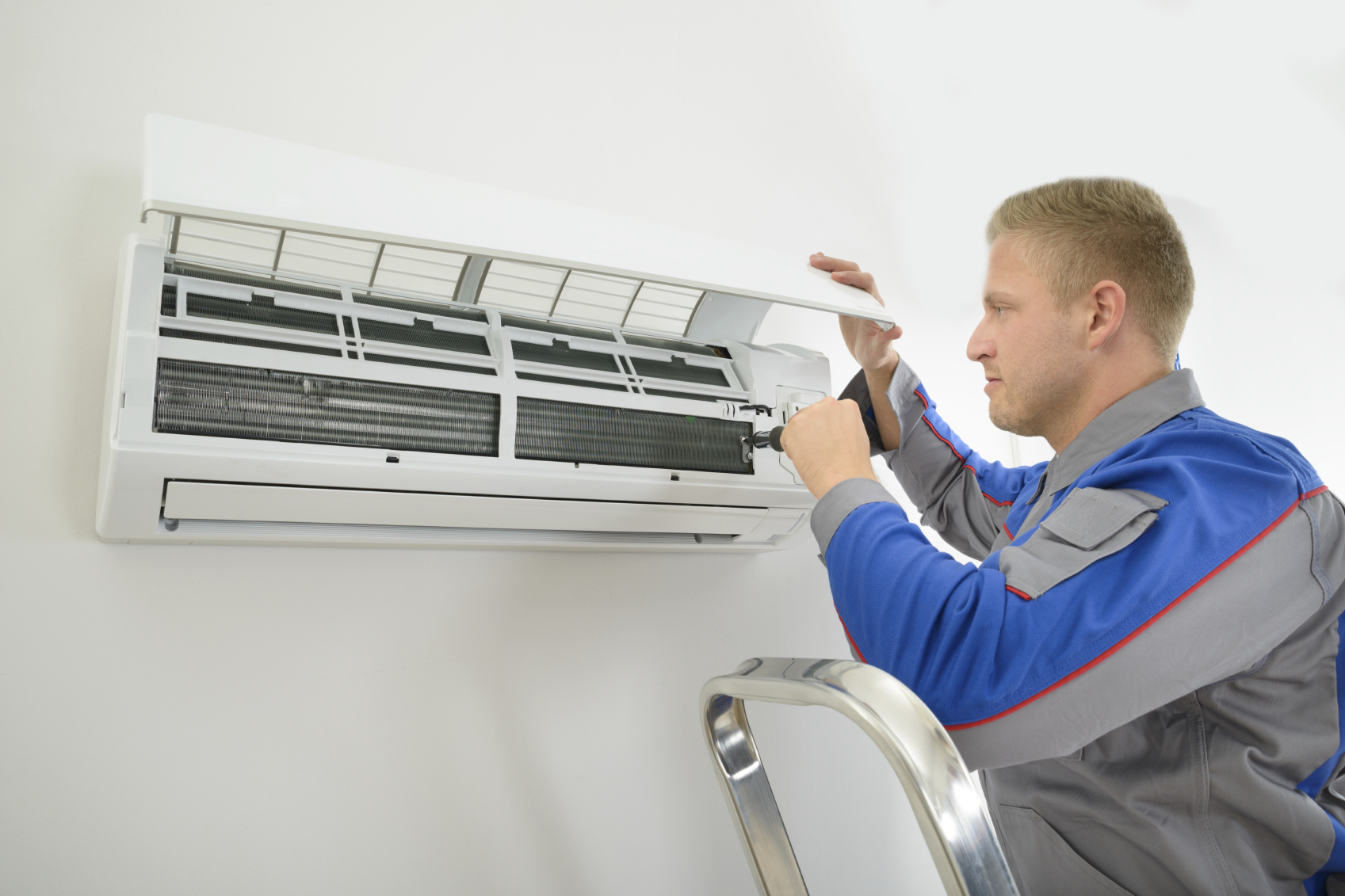 Get your AC Repaired. Image Courtesy: tweedysheatingandair.com
